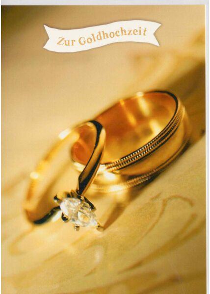 Glückwunschkarte zur Goldhochzeit zwei goldene Ringe