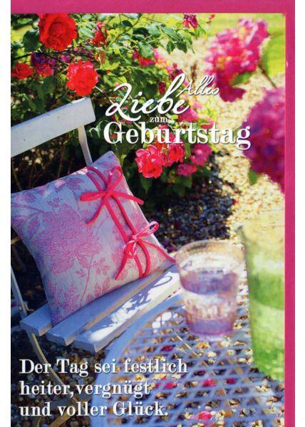 Geburtstagskarte Land Natur: Stuhl mit Zierkissen, Tisch mit Gläsern, dahinter Blumen