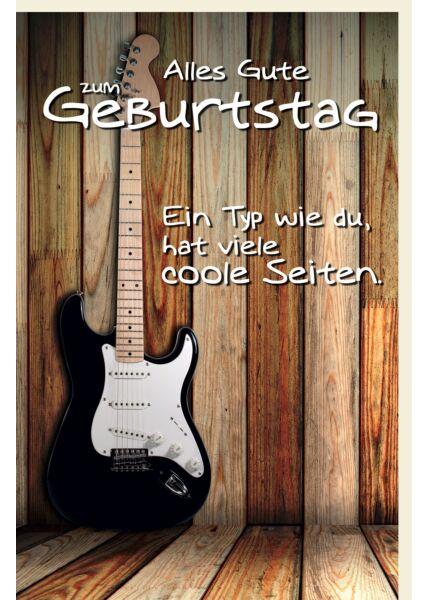 Glückwunschkarte Geburtstag Gitarre lehnt an Holzwand